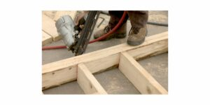 A picture of building a wall with wood studs, the old-fashioned way