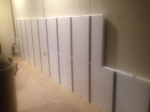 Picture of InSoFast insulation panels going up in mu basement