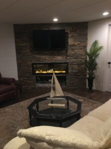 A picture of the newly finished fireplace wall in my new basement