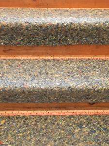 A picture of stairs with carpet pad still intact