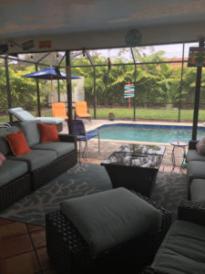 A picture of the comfortable lanai and pool area at the vacation house