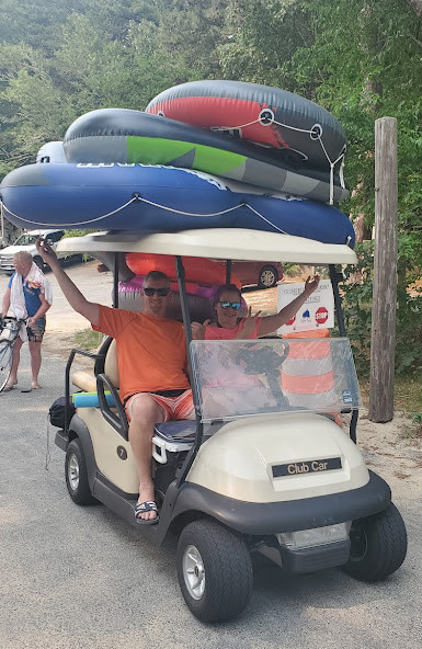 Golf cart toting inflatables