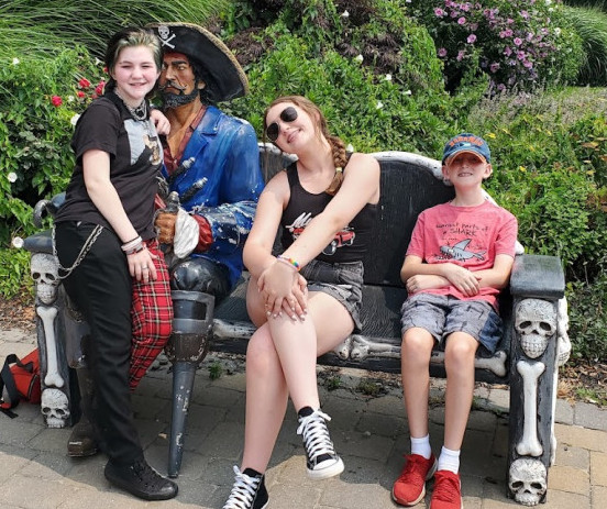 Kids sitting with pirate